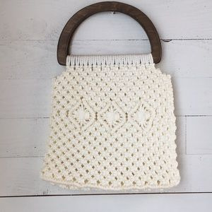 Handmade knitted purse with wood handles